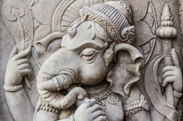 Zamyka w górę ganesh hinduskiego bóg twarzy. Premium Zdjęcia