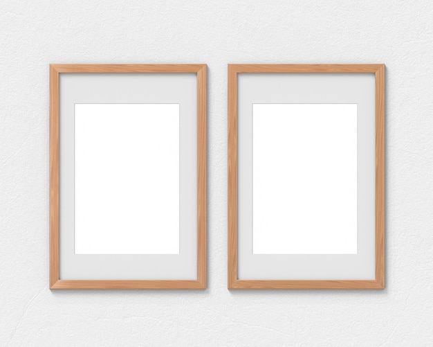 Zestaw 2 Makiet Pionowych Drewnianych Ram Z Wiszącą Na ścianie Ramką. Pusta Podstawa Na Zdjęcie Lub Tekst. Renderowanie 3d. Premium Zdjęcia