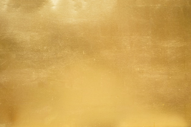 Złocisty tło, tekstura lub gradient cień. Premium Zdjęcia