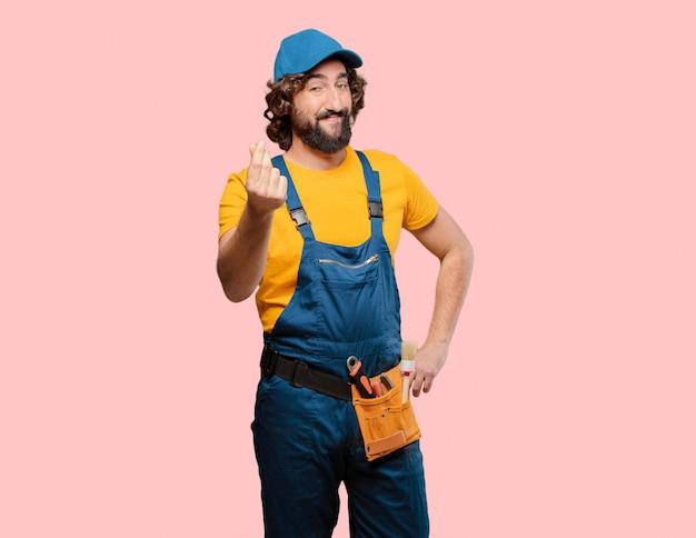 Złota rączka pracownika pieniądze znak Premium Zdjęcia