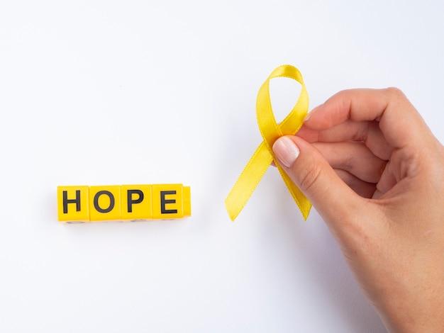 Złota wstążka podnosząca świadomość raka dzieci Darmowe Zdjęcia
