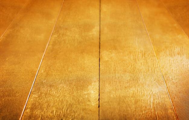 Złote tło złota drewniana malująca wieśniaka stołu tekstura Premium Zdjęcia