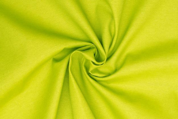 Zmięty Neonowy Zielony Wapno Textured Tkaniny Tło Premium Zdjęcia