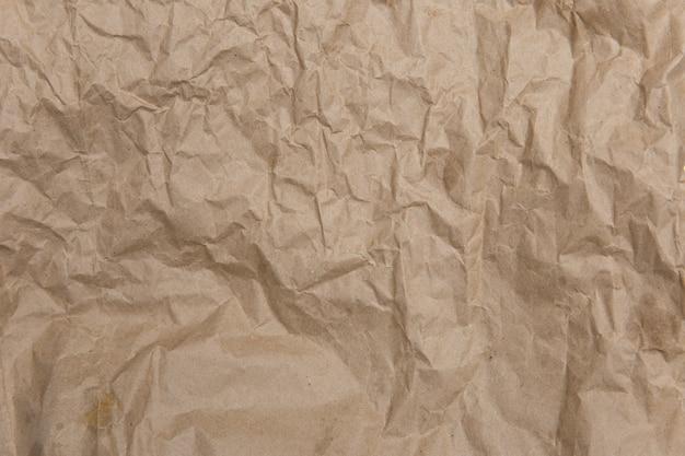 Zmięty Stary, Brązowy, żółty Papier. Szorstka Stara Tekstura. Abstrakcyjne Tło Z Miejscem Na Tekst. Koncepcja Starzenia. Premium Zdjęcia