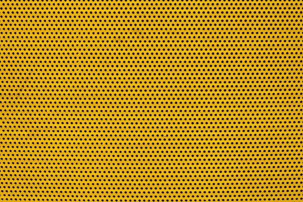 Żółtego Koloru Metalowa Płytka Z Wieloma Małymi Okrągłymi Dziurami Kropkuje Teksturę Dla Tła Premium Zdjęcia