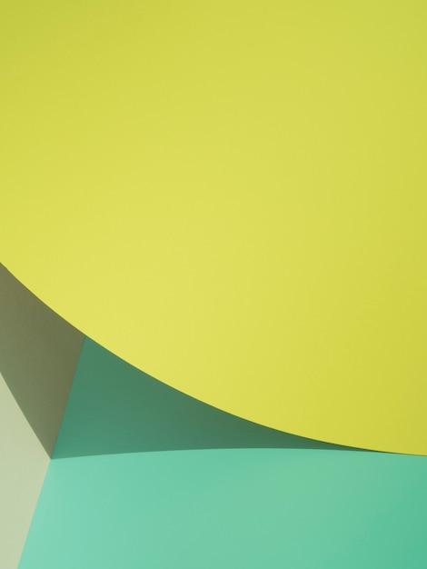Żółty abstrakcyjne kształty papieru z cieniem Darmowe Zdjęcia