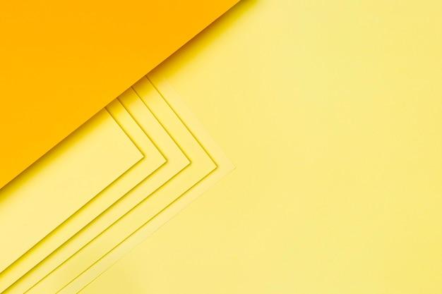 Żółty Papier Kształtuje Projekt Tła Premium Zdjęcia