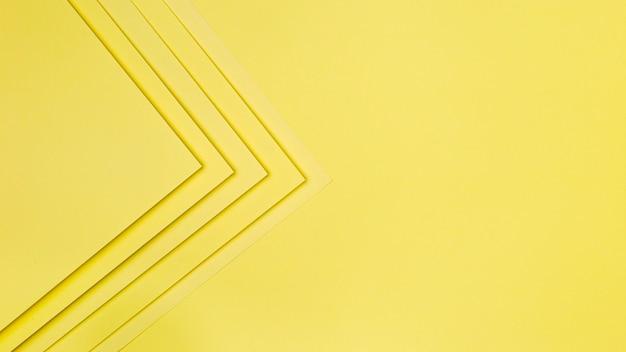 Żółty Papier Kształtuje Tło Premium Zdjęcia