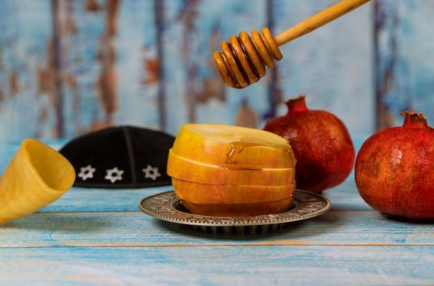 Żydowskie święto Rosz Haszana Miód I Jabłka Z Granatem Premium Zdjęcia