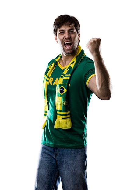 Abanico brasileño celebrando, en un espacio en blanco. Foto Premium