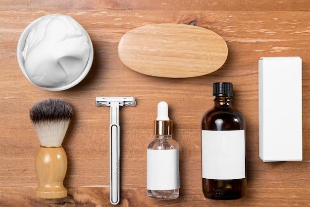 Aceite y accesorios de peluquería de vista superior Foto gratis