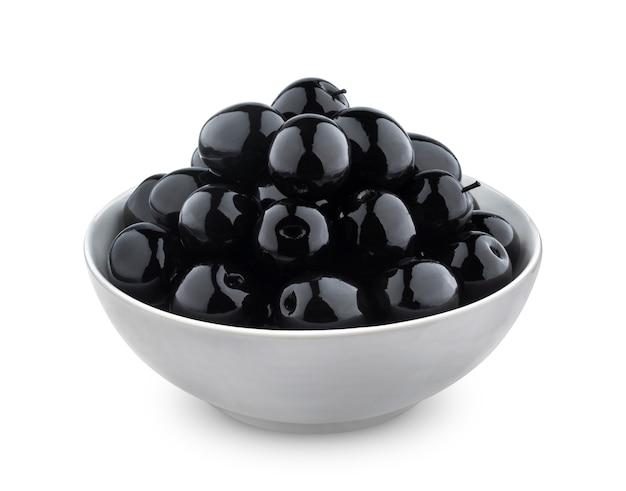 Aceitunas negras aisladas sobre fondo blanco Foto Premium