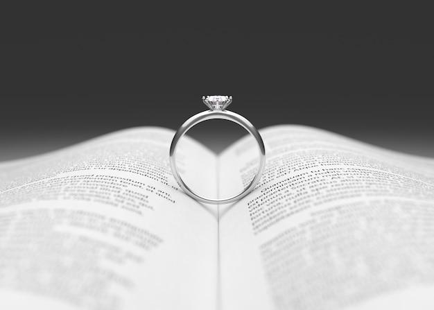 Anillo de bodas en la página del libro representación 3d   Descargar ...
