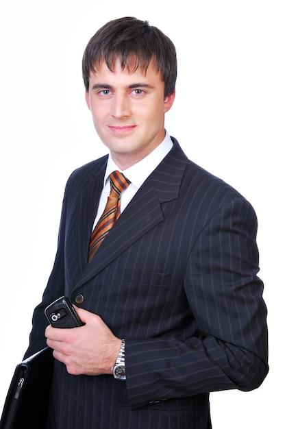 Apuesto hombre de negocios sosteniendo la carpeta negra Foto gratis