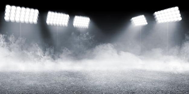 Arena deportiva con piso de concreto con fondo de humo y focos Foto Premium