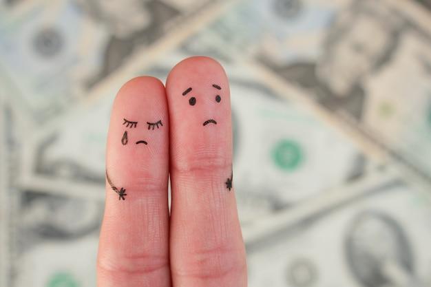 Arte de los dedos de la pareja disgustada en el fondo de dinero Foto Premium