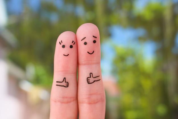 Arte de los dedos de los pares felices que muestran los pulgares para arriba. Foto Premium
