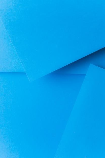 El azul surge el fondo de papel abstracto Foto gratis