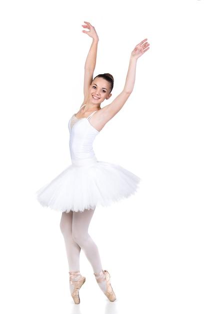 Bailarín de ballet hermoso joven en el baile en el sitio blanco. Foto Premium