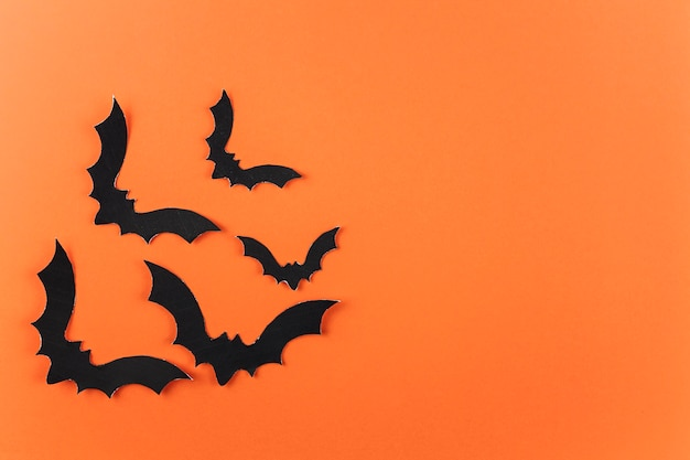 Bandada de murciélagos de papel negro Foto gratis