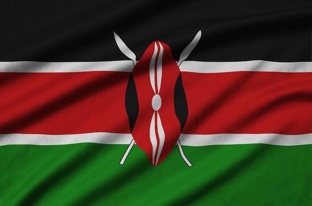 La bandera de kenia está representada en una tela de tela deportiva con muchos pliegues. Foto Premium