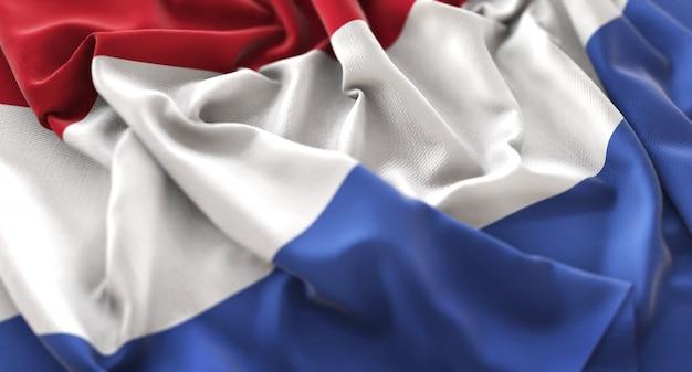 Bandera de los países bajos ruffled maravillosamente acurrucado horizontal primer plano color Foto gratis