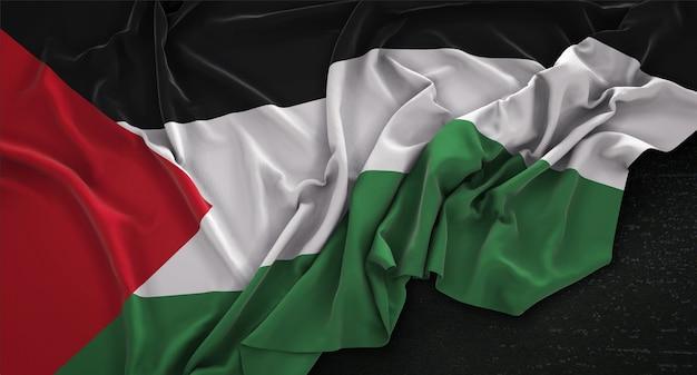 Bandera de palestina arrugada sobre fondo oscuro 3d render Foto gratis