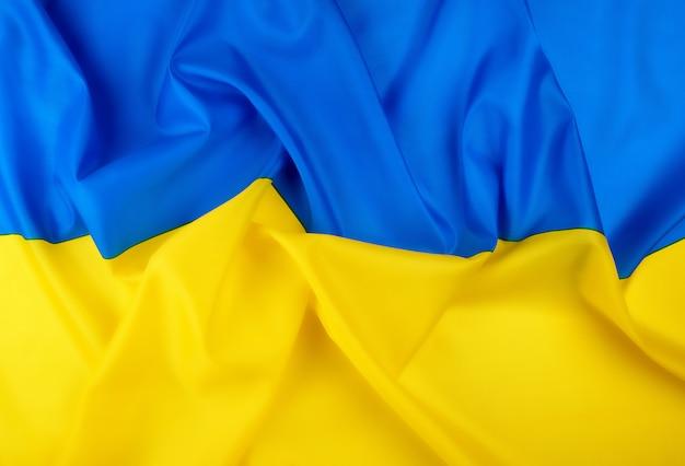 Bandera de seda textil azul-amarilla del estado de ucrania Foto Premium