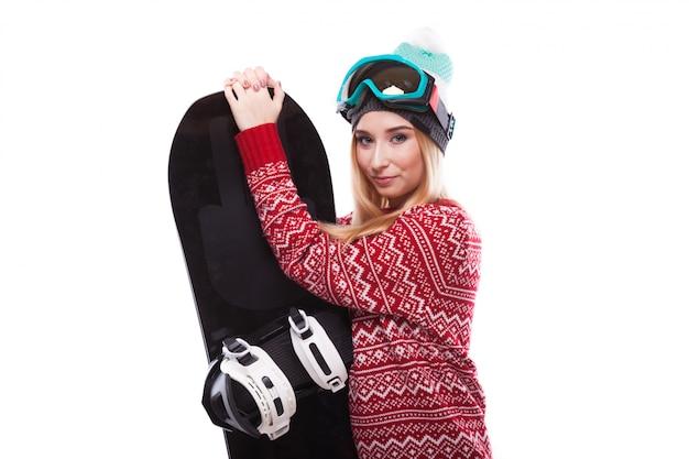Bastante joven en casa jersey con tabla de snowboard Foto Premium