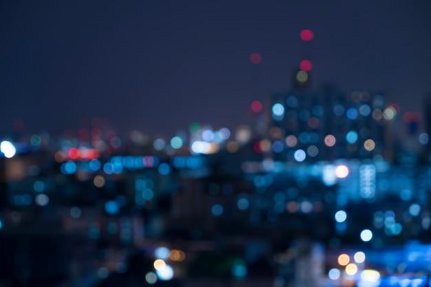 Bokeh luz urbana abstracta de la noche, fondo defocused Foto gratis
