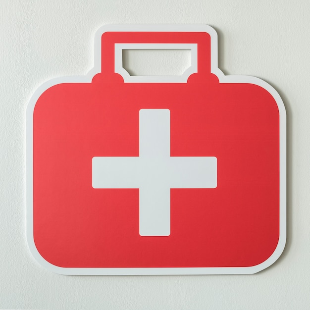 Bolsa de primeros auxilios icono de papel artesanal Foto gratis