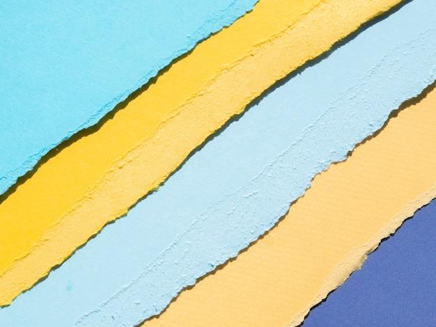 Bordes de papel rasgado abstracto naranja y azul Foto gratis