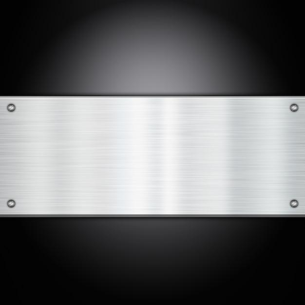 Brillante placa de metal sobre un fondo de fibra de carbono Foto gratis