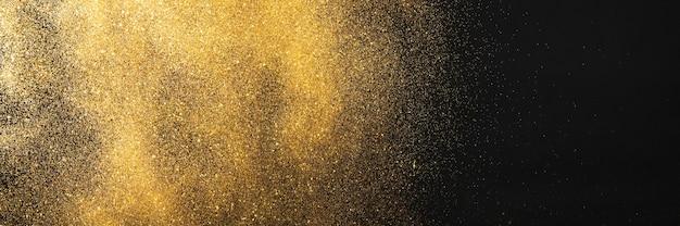 Brillo dorado sobre fondo negro Foto Premium
