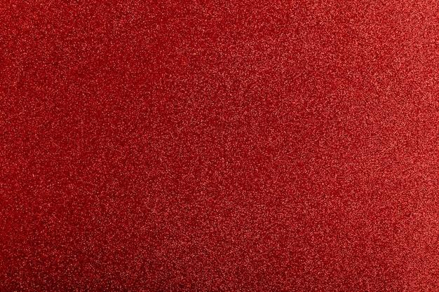 El brillo rojo enciende el modelo del fondo desenfocado. Foto Premium