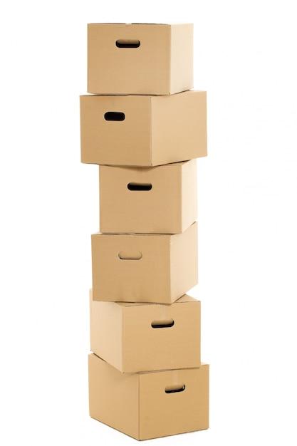 Cajas vacías y cerradas en el blanco Foto gratis