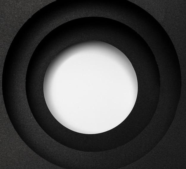 Capas de fondo negro circular y círculo blanco Foto gratis