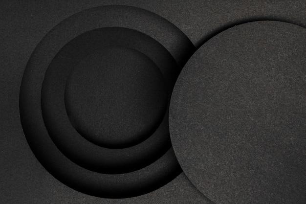 Capas de fondo negro circular Foto gratis