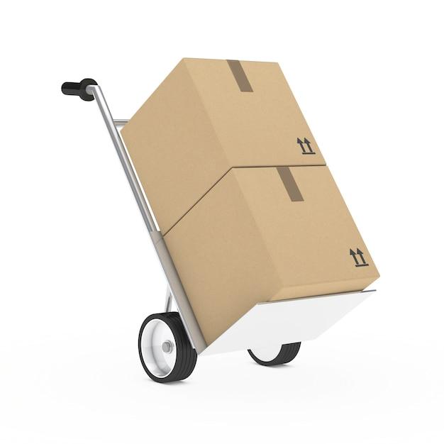 Carretilla con dos cajas de cartón Foto gratis