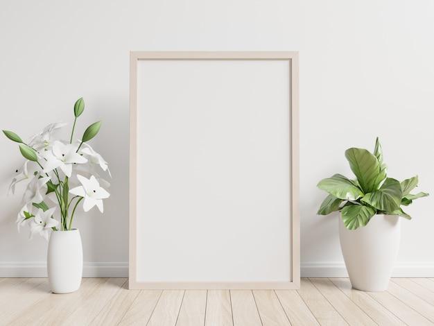 Cartel interior simulacro con macetero, flor en la habitación con pared blanca Foto Premium