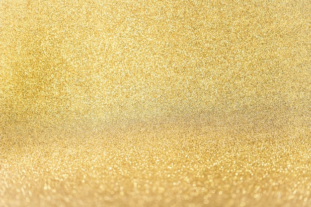 Cerca de fondo dorado brillo Foto gratis