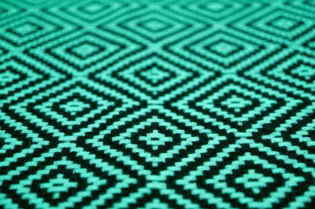 Cerrado con una hermosa tela verde menta y un patrón étnico de color negro Foto Premium