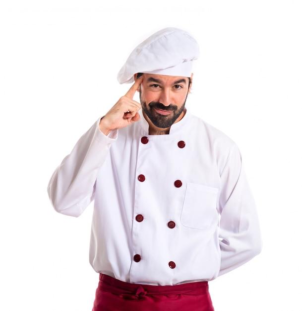 Chef pensando sobre fondo blanco Foto gratis