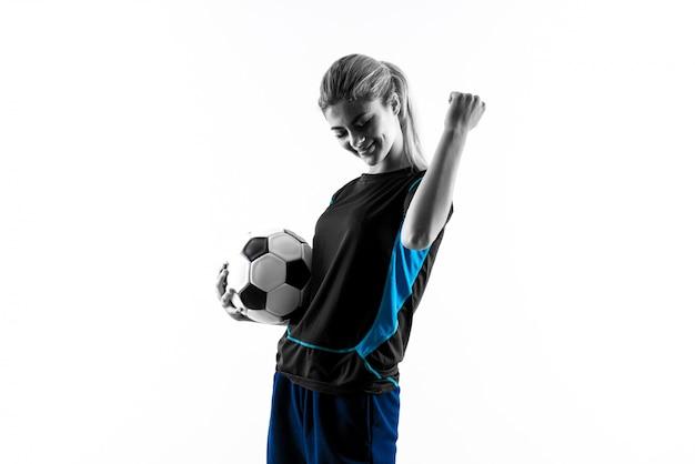 Chica adolescente rubia futbolista sobre pared blanca aislada Foto Premium