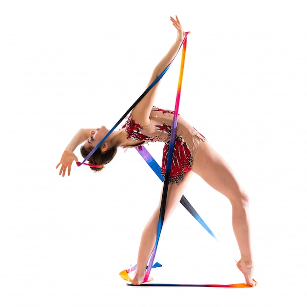 Chica haciendo gimnasia rítmica con cinta Foto Premium