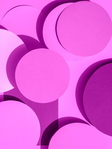 Círculos de papel violeta de fondo geométrico Foto gratis