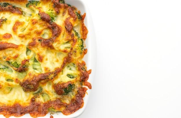 Coliflor al horno con brócoli al queso Foto Premium