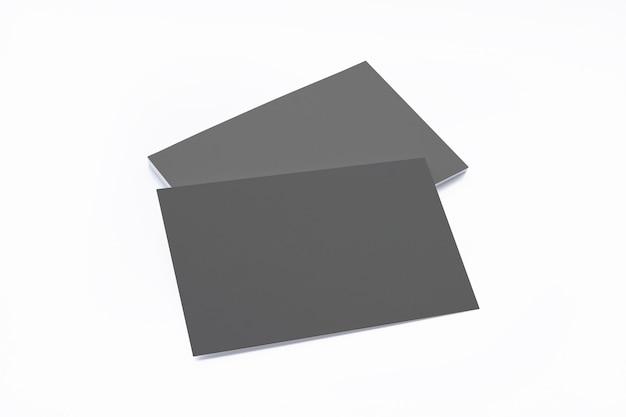 Composición de tarjetas de visita negra en blanco aislada en blanco Foto gratis
