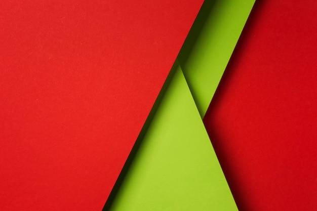 Composición de la vista superior de hojas de papel de colores Foto gratis