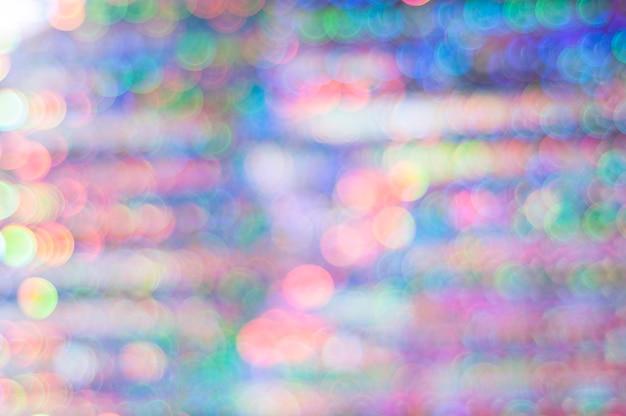 Concepto de año nuevo, fondo de navidad. bokeh multicolor en tonos rosas y azules. Foto Premium